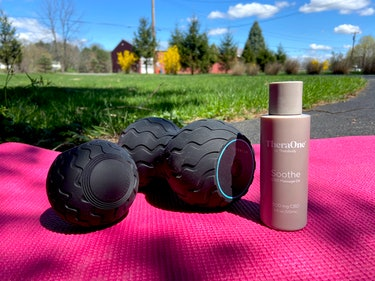 Wave Solo and Duo are shown atop a pink yoga mat in an outdoor setting. A bottle of CBD oil stands n...