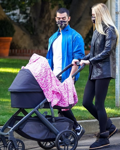 Joe Jonas and Sophie Turner out for a walk with their daughter in Los Angeles.