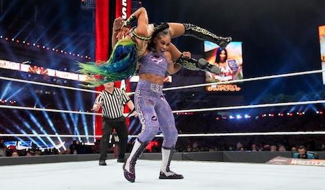 Bianca Belair lifts up Sasha Banks during a match at Wrestlemania 37 on Saturday, April 10, 2021.