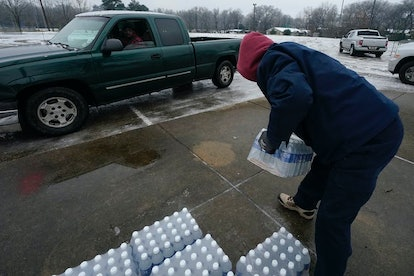 Jackson, Mississippi, residents pick up bottled water at a city distribution center on Feb. 18, 2021...