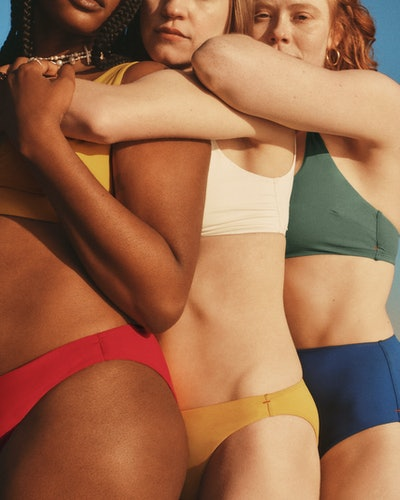 Models wearing swimsuits from Everlane's first swimwear collection.