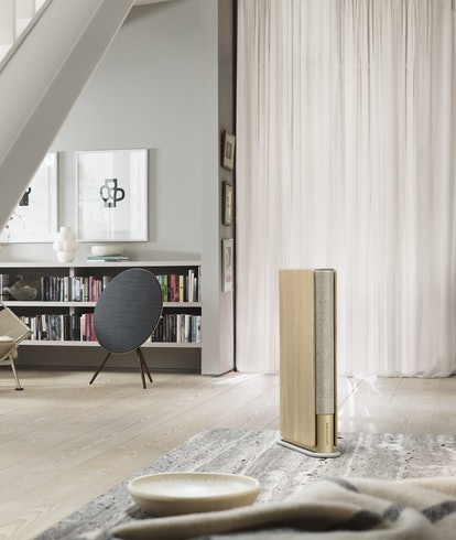 A Bang and Olufsen speaker is set in a lounge.