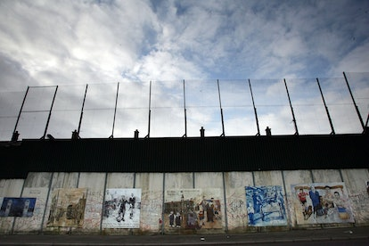 """The """"Peace Line"""" fence, which stretches between the Catholic and Protestant areas of West Belfast, N..."""