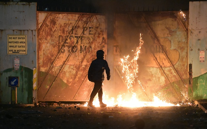 Nationalists and Loyalists riot against one another at the Peace Wall interface gates which divide t...