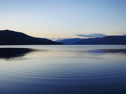 ripples in water after throwing pebble into Loch Katrine, Scotland