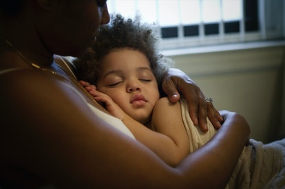 Mother holding sleeping son -