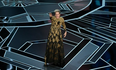 Frances McDormand on stage waving at crowd