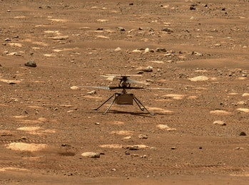An image of the Ingenuity helicopter on the surface of Mars as captured by the Perseverance rover.