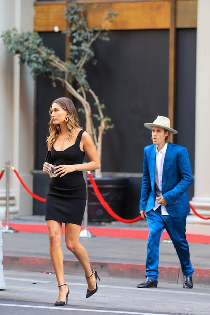 Stylish couple Justin and Hailey Bieber put on their best attire as they attend Musician Harv's wedding in Los Angeles. Justin opted for a bold look in a royal blue suit with a beige wide-brimmed hat, while his wife Hailey kept it classic in a little black dress.
