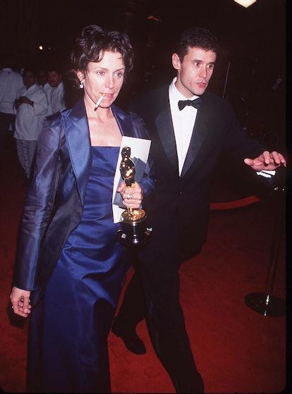 Frances McDormand smoking a cigarette and holding her Oscar