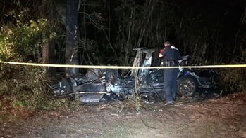 Two men were killed after a Tesla Model S crashed into a tree. Nobody was seated in the driver's seat, according to officials.