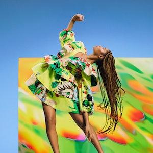 Model wearing a Christopher John Rogers dress from Target's Spring 2021 Designer Dress Collection.