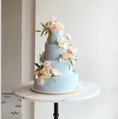 blue tiered cake with spring flowers