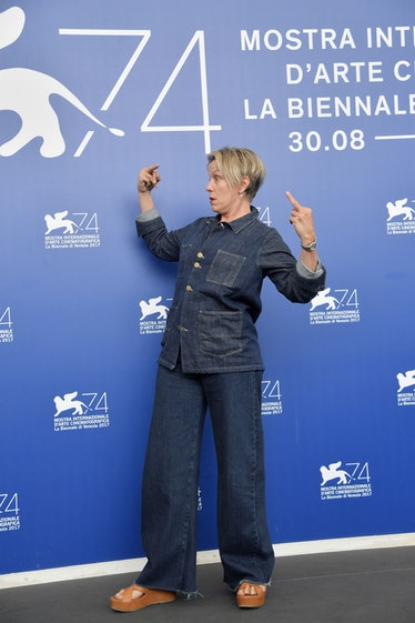 Frances McDormand wearing denim and flipping off cameras