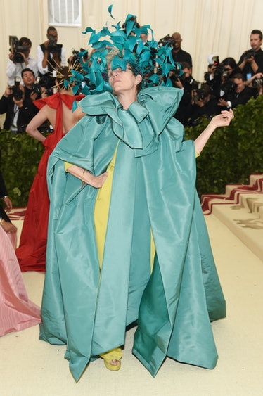 Frances McDormand wearing a blue feather headdress at the Met Gala