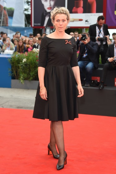 Frances McDormand on the red carpet in a black dress