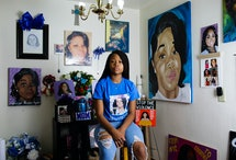 """Ju'Niyah Palmer, who is the sister Breonna Taylor poses for a portrait surrounded by photos and paintings of her sister at her mother's apartment Tuesday, August 4, 2020 in Louisville, Kentucky. Breonna Taylor was shot and fatally wounded on March 13 when plainclothes Louisville Metro Police Department officers executed a """"No-Knock"""" warrant at her apartment during a narcotics investigation. Photo by"""