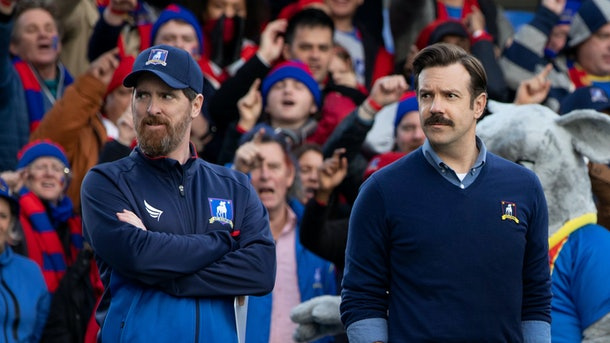 Brendan Hunt as Coach Beard and Jason Sudeikis as Ted Lasso in Ted Lasso