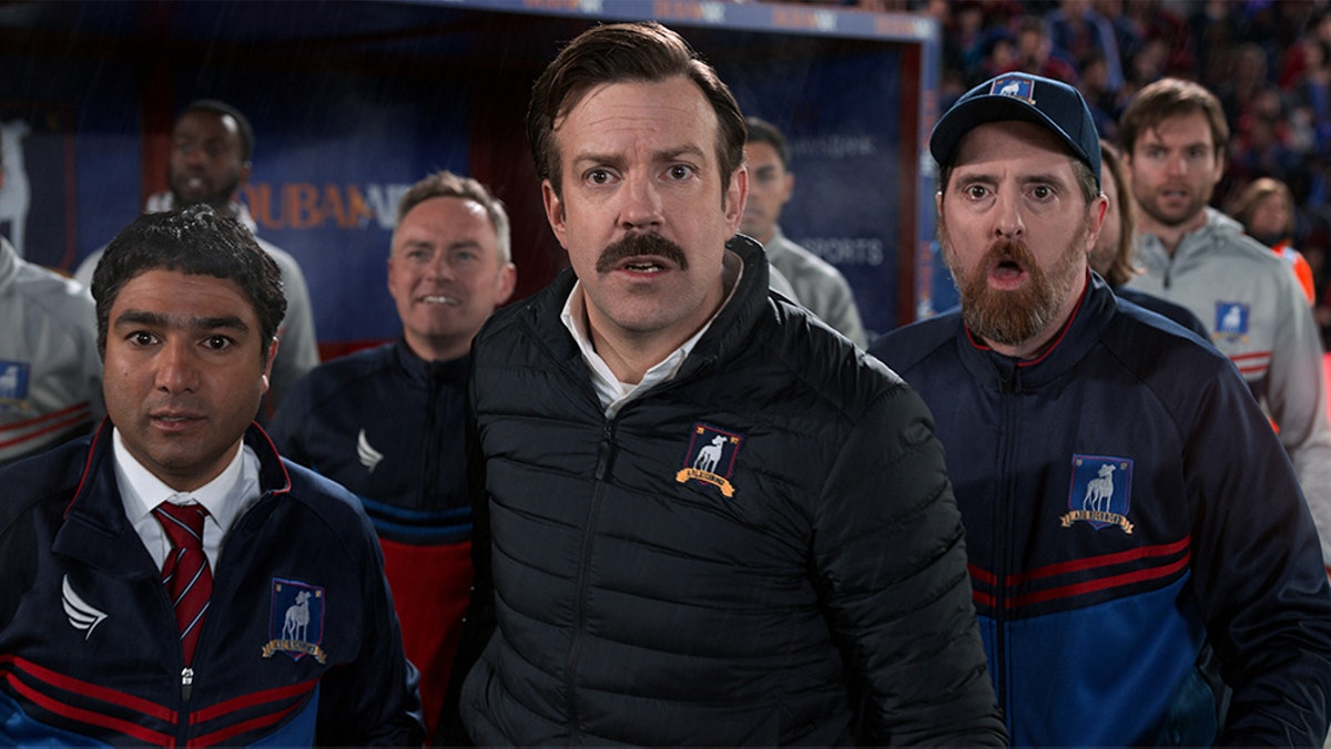Nick Mohammed as Nate The Great, Jason Sudeikis as Ted Lasso, and Brendan Hunt as Coach Beard in Ted Lasso