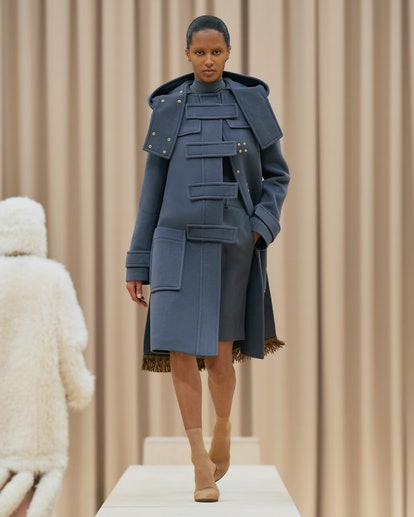 Model walks in Burberry's Fall/Winter 2021 show in a blue trench coat.