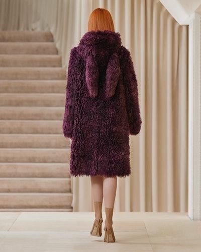 Model walks in Burberry's Fall/Winter 2021 show wearing a furry coat.