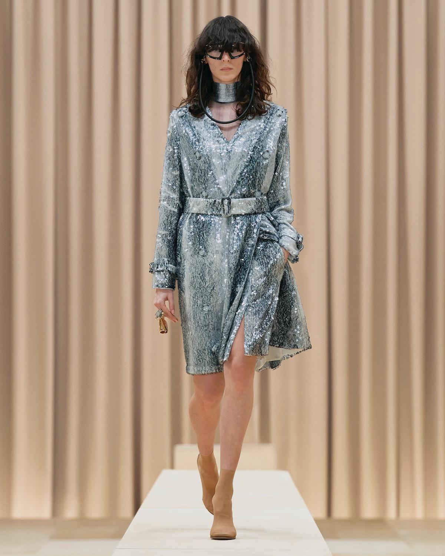 Model walks in Burberry's Fall/Winter 2021 show wearing a dress.