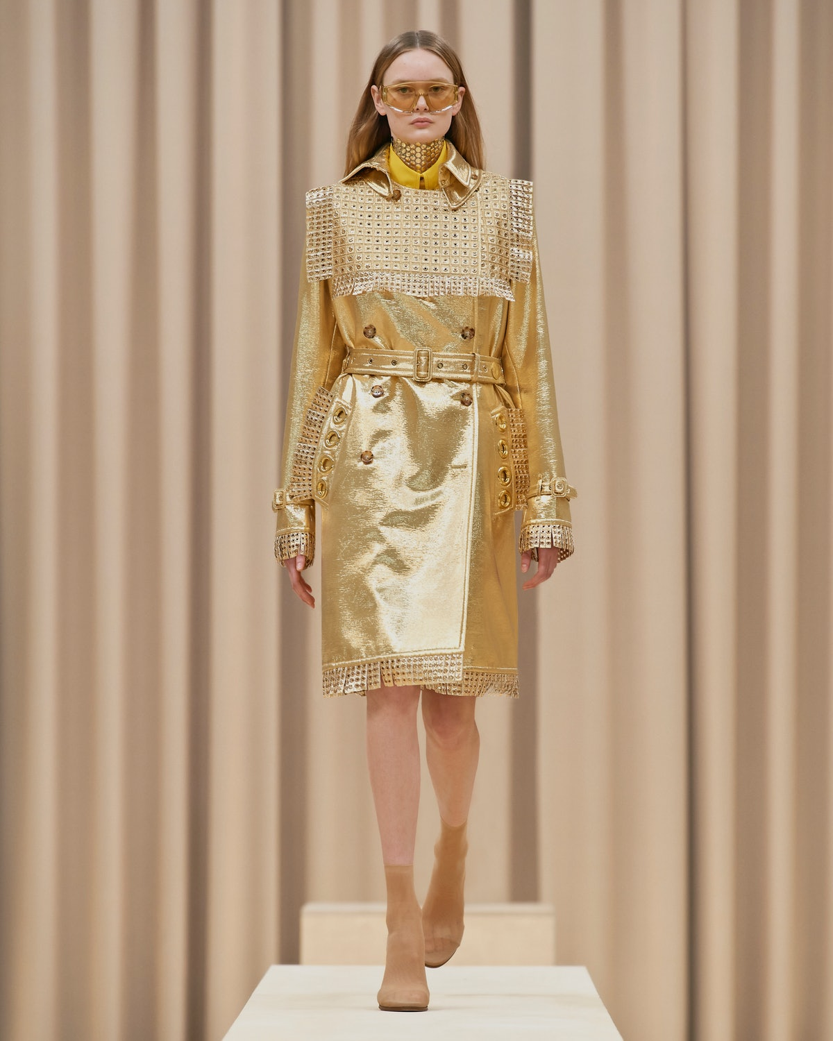 Model walks in Burberry's Fall/Winter 2021 show in an all gold outfit.