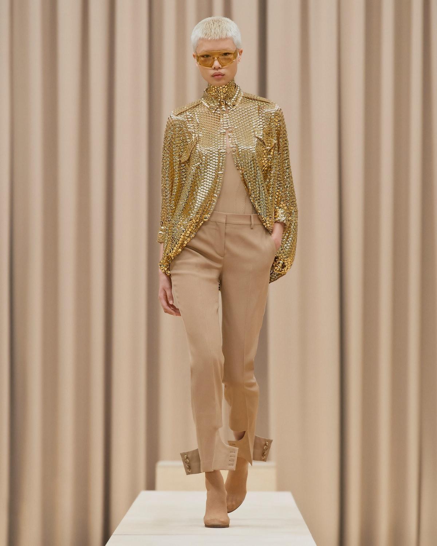 model in gold top khaki pants