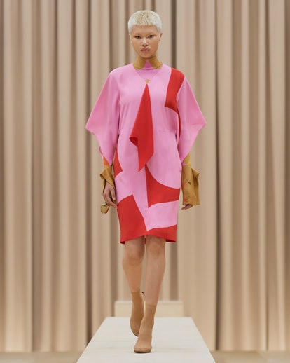 Model walks in Burberry's Fall/Winter 2021 show in a pink dress.