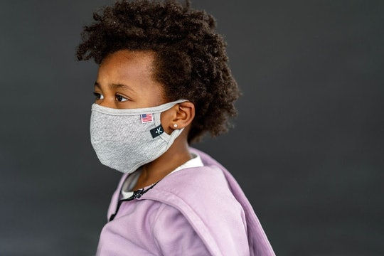 kid in face mask