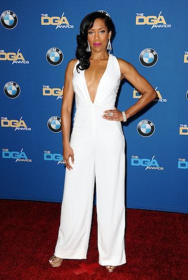 Regina King wearing white pantsuit