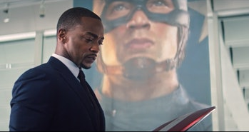 Anthony Mackie as Sam Wilson behind Captain America portrait in The Falcon and the Winter Soldier