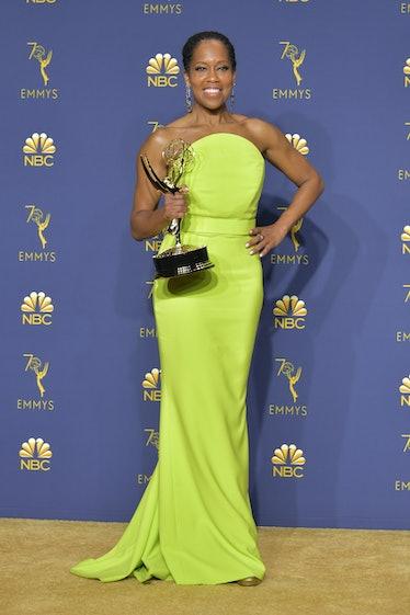 Regina King holding her Emmy