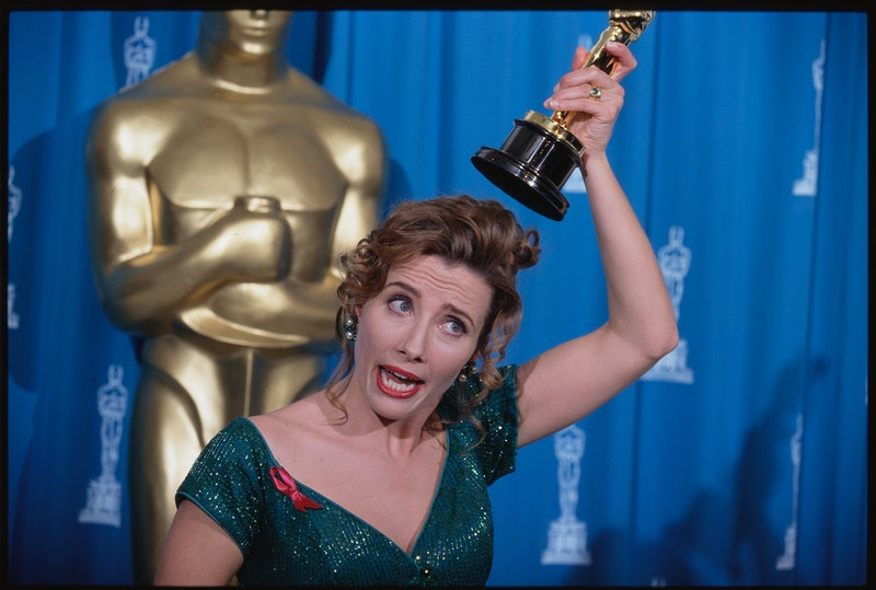 Emma Thompson holds her Oscar statuette over her head at the 65th Academy Awards