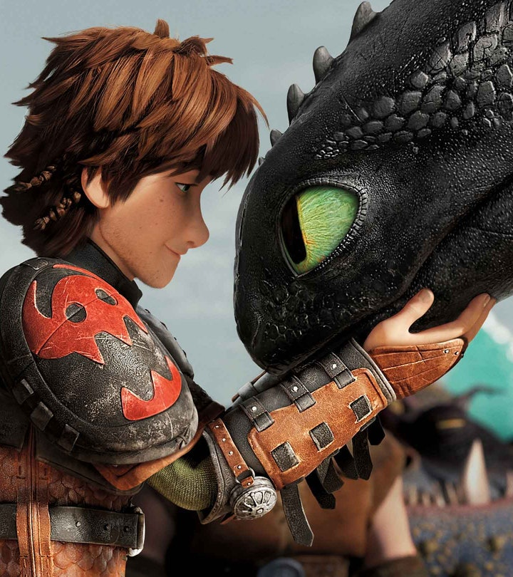 """Hiccup stands next to his dragon friend, Toothless, in a still from """"How To Train Your Dragon."""""""
