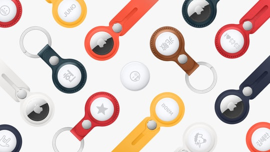 A variety of Apple's new tracking device, the AirTag, are seen displayed alone and inside of leather bag charms and keychains designed by Hermès.