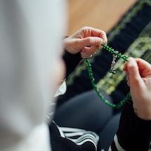 A woman praying during Ramadan.