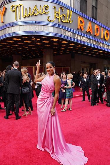 Regina King pointing at Radio City Music Hall sign