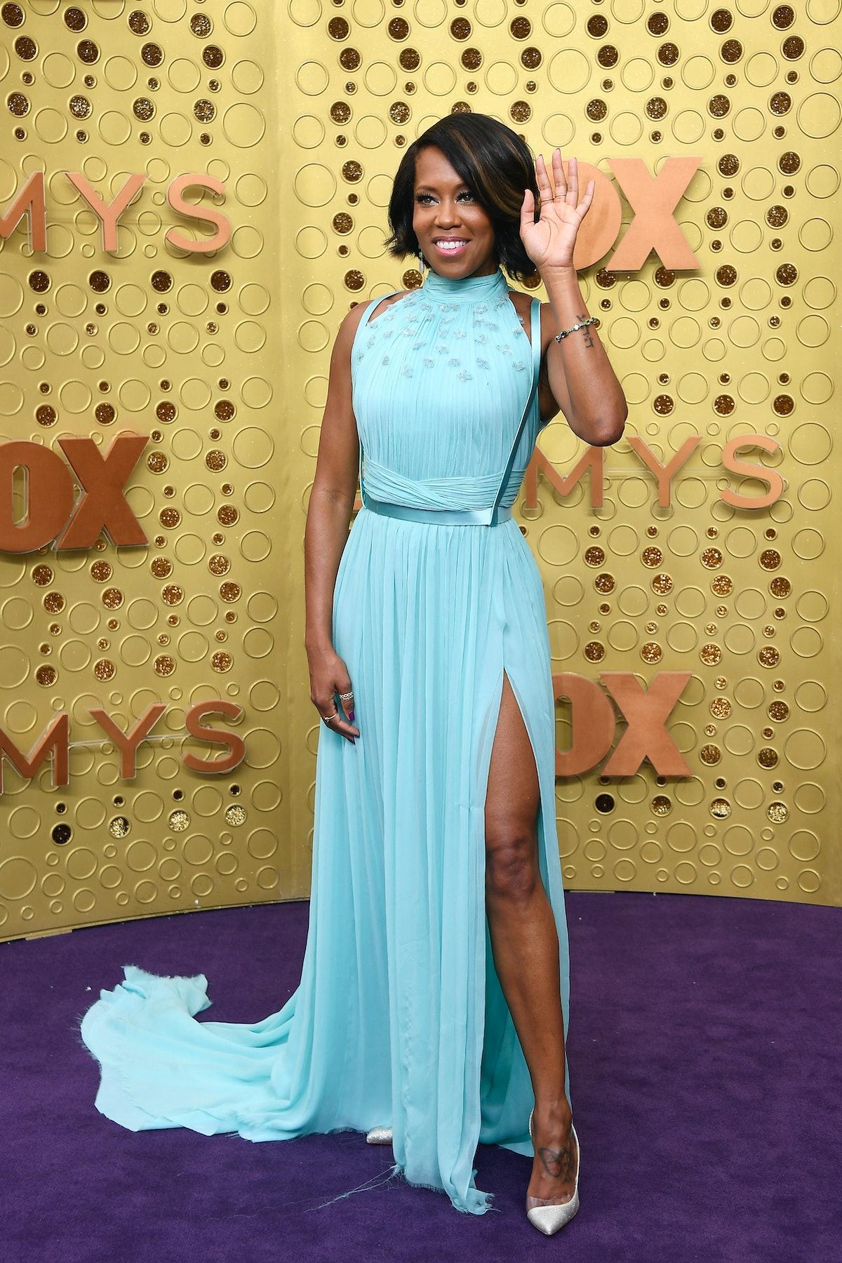 Regina King waves on the Emmys carpet