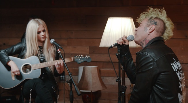 "Avril Lavigne and Mod Sun shared the video for their acoustic ""Flames"" session."