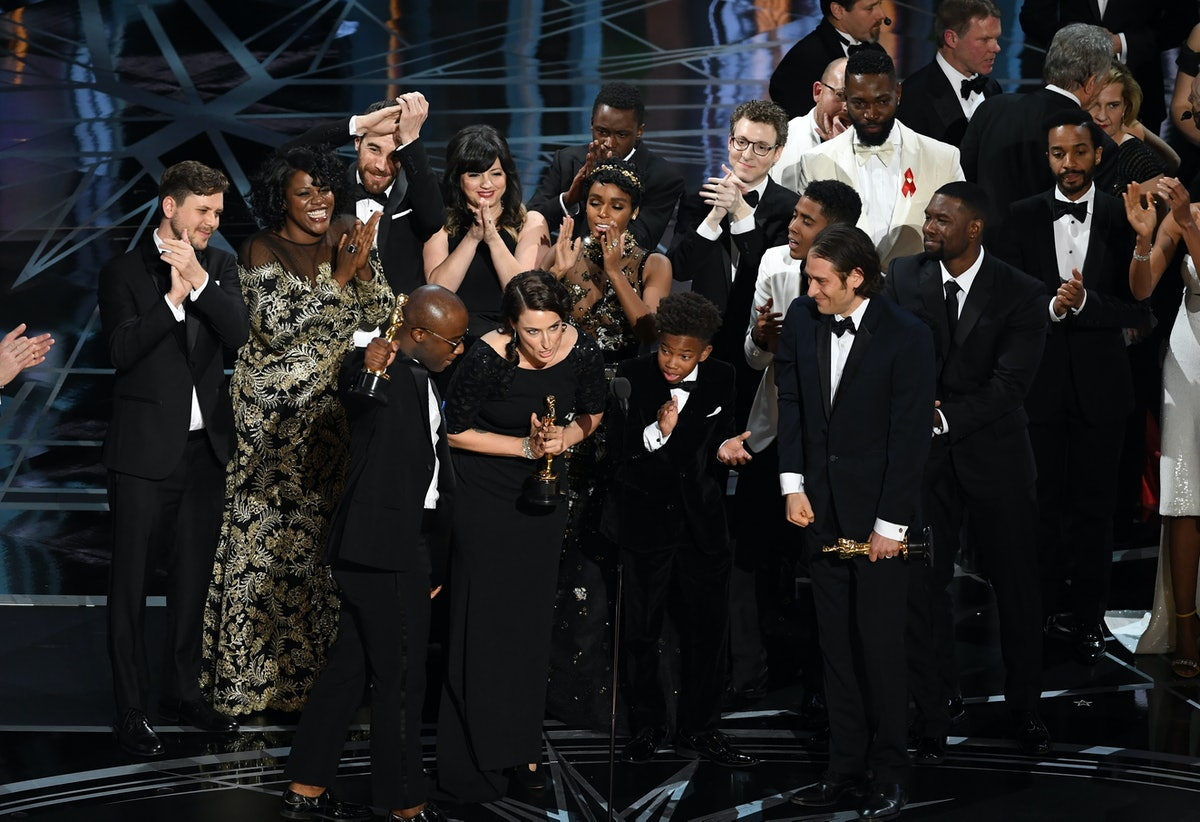 The cast and crew of 'Moonlight' accept the Best Picture award.
