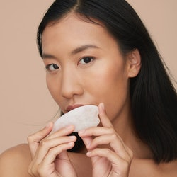 How to give yourself a gua sha facial, according to beauty pros.