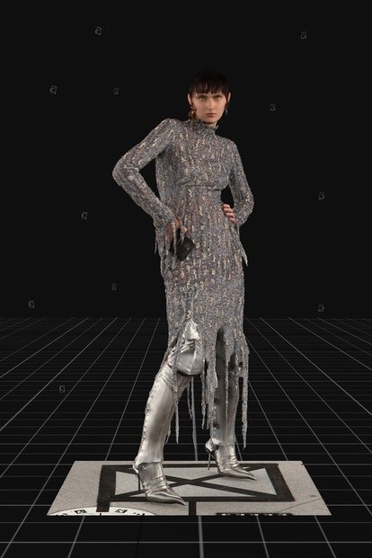 Model wearing Balenciaga's Silver Embroidered Flame Dress during the brand's Fall Winter 2021 runway...