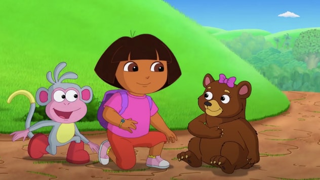 Dora and Boots sit with a bear
