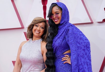Agnes Wilson, left, and H.E.R. LOS ANGELES, CALIFORNIA – APRIL 25: Agnes Wilson (L) and H.E.R. attend the 93rd Annual Academy Awards at Union Station on April 25, 2021 in Los Angeles, California.