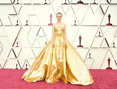 Carey Mulligan wearing a gold dress
