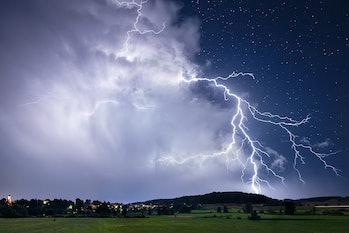 Lightning strikes ground from thundercloud