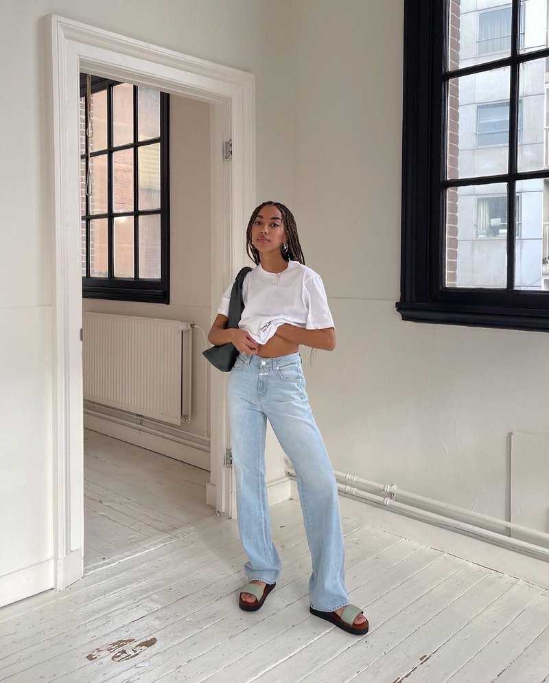 Influencer and Instagram content creator Amaka Hamelijnck wearing baggy jeans from Closed Official with slides.