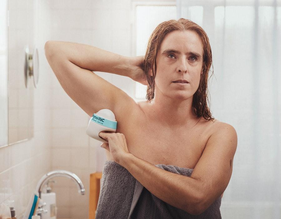 Image of woman using Degree Inclusive deodorant.
