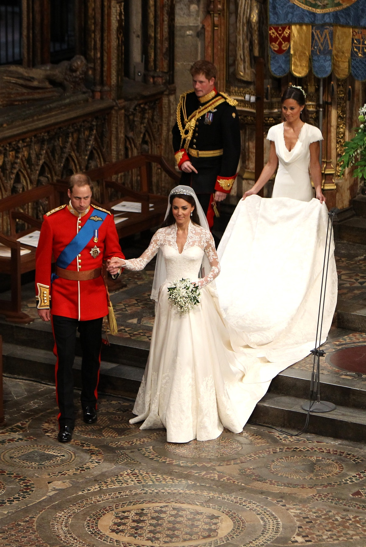 TRH Prince William, Duke of Cambridge and his new bride Catherine, Duchess of Cambridge walk down the aisle followed by best man Prince Harry and Maid of Honour Pippa Middleton